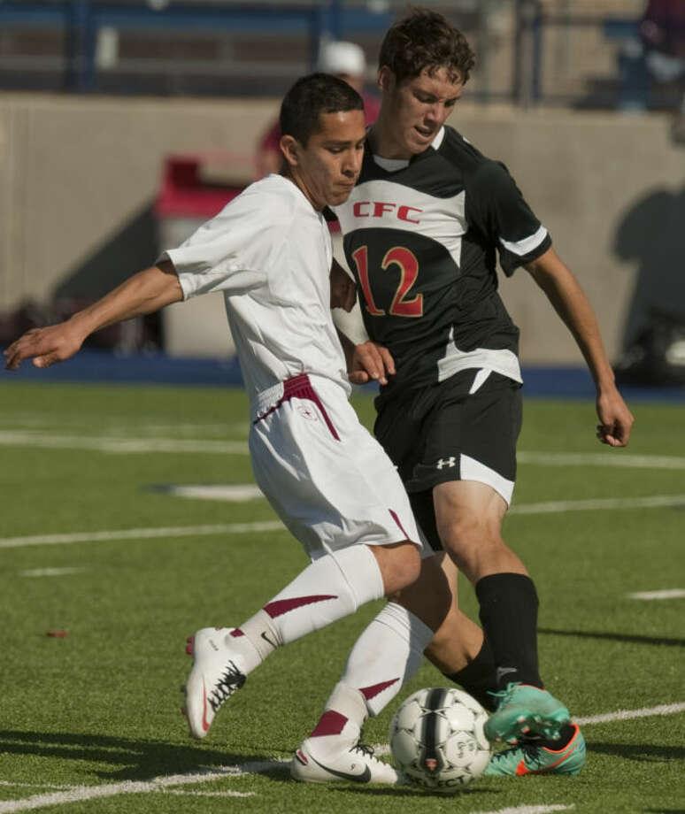 Lee High's Cesar Gonzalez battles for the ball with Lubbock Coronado's Cameron Lugo Saturday at Grande Communication Stadium. Tim Fischer\Reporter-Telegram Photo: Tim Fischer