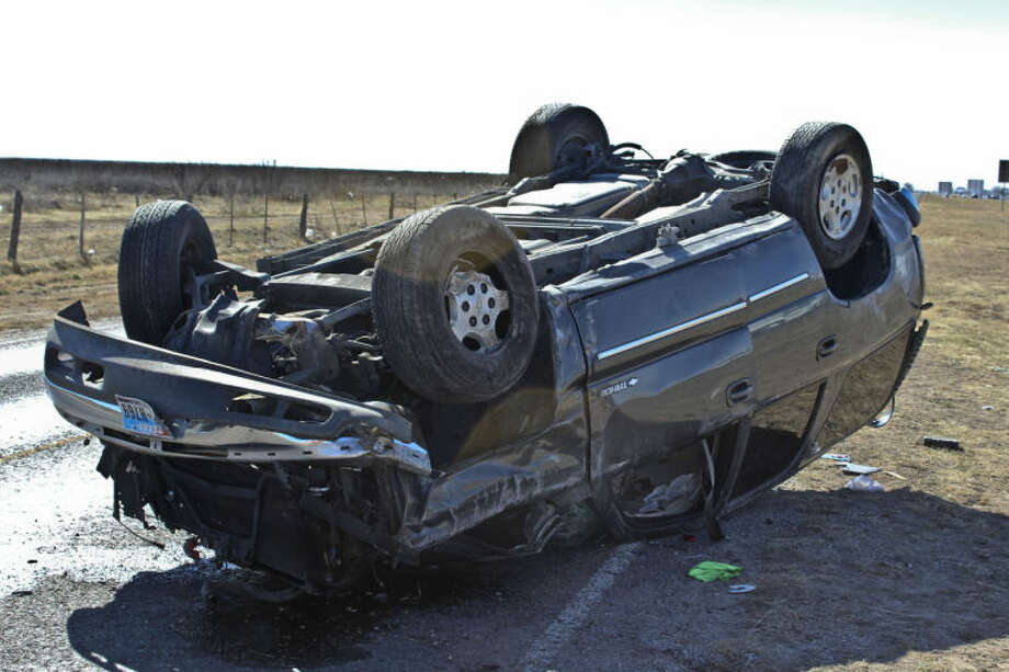 A SUV sustained significant damage after a rollover crash Monday afternoon on Interstate 20. Tyler White/Reporter-Telegram Photo: Tyler White