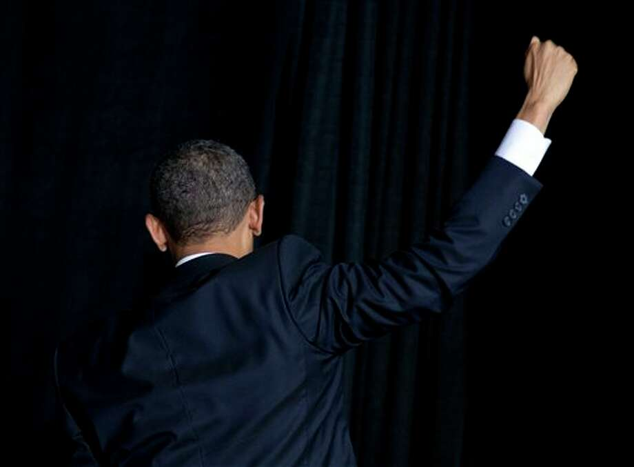 President Barack Obama turns to leave after shaking hands and speaking about immigration at Del Sol High School, Tuesday, Jan. 29, 2013, in Las Vegas. (AP Photo/Carolyn Kaster) Photo: Carolyn Kaster / AP