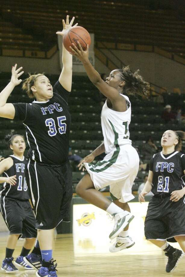 Frank Phillips Destiny Phillips (35) tries to block Midland College's Darnetta Jackson (11) as she goes to the air to attempt the shot for two Thursday at the Chaparral Center. Cindeka Nealy/Reporter-Telegram Photo: Cindeka Nealy