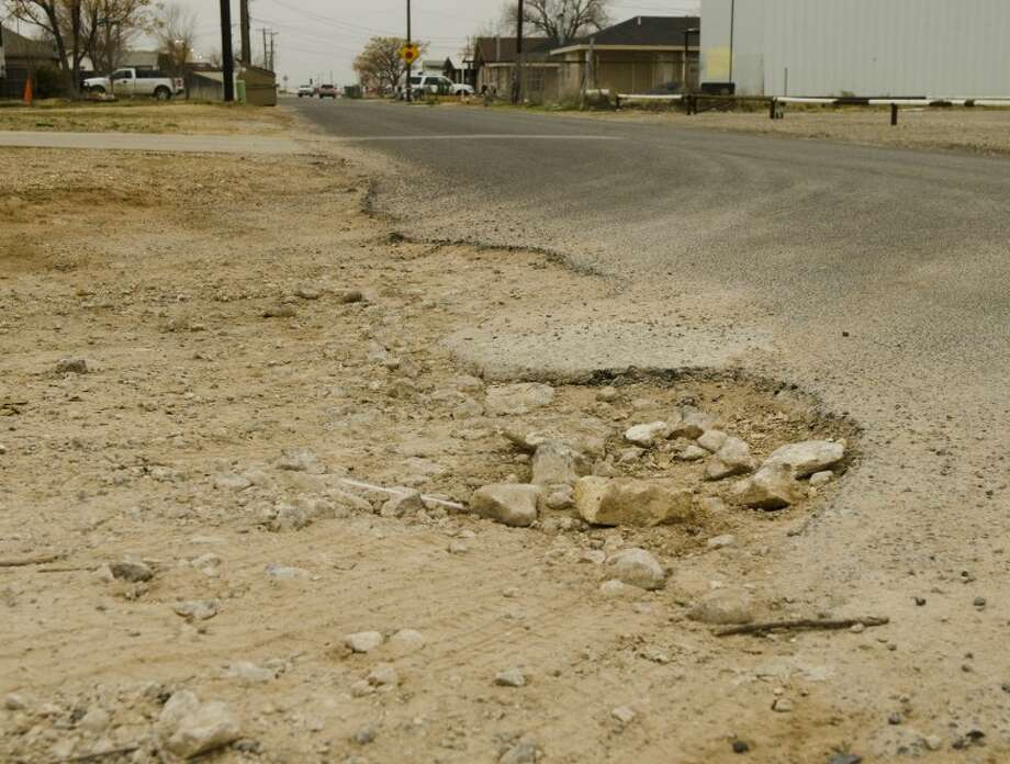 The city of Midland has plans to repair and/or pave roads on the south side of Mildland, like this intersection of Longview Avenue and Fort Worth Street. Photo: Tim Fischer/Reporter-Telegram