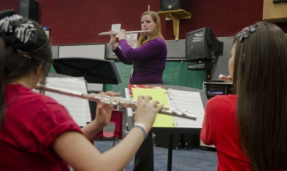 Michele Kahne, assistant band director, works with students at Goddard Junior High. Photo by Tim Fischer/Midland Reporter-Telegram Photo: Tim Fischer