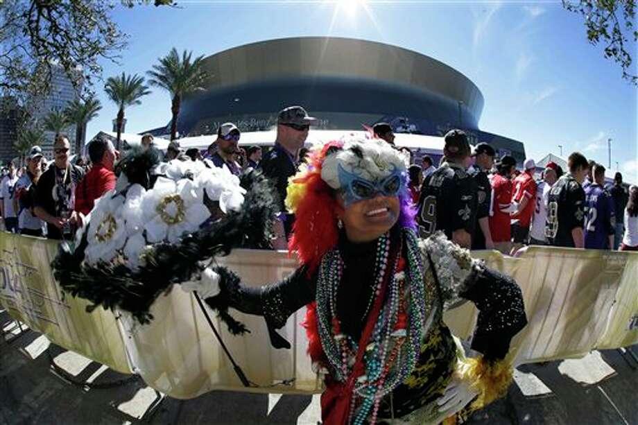 Jennifer Jones dances outsidethe Superdome before the NFL Super Bowl XLVII football game between the San Francisco 49ers and the Baltimore Ravens on Sunday, Feb. 3, 2013, in New Orleans. (AP Photo/Gene Puskar) Photo: Gene Puskar / AP2013