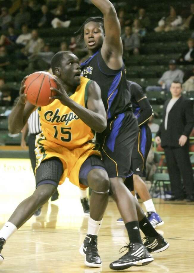 Midland College's Majok Majok (15) sets up to take the shot as he's guarded by Frank Phillips Akeem Johnson (11) Thursday at the Chaparral Center. Cindeka Nealy/Reporter-Telegram Photo: Cindeka Nealy