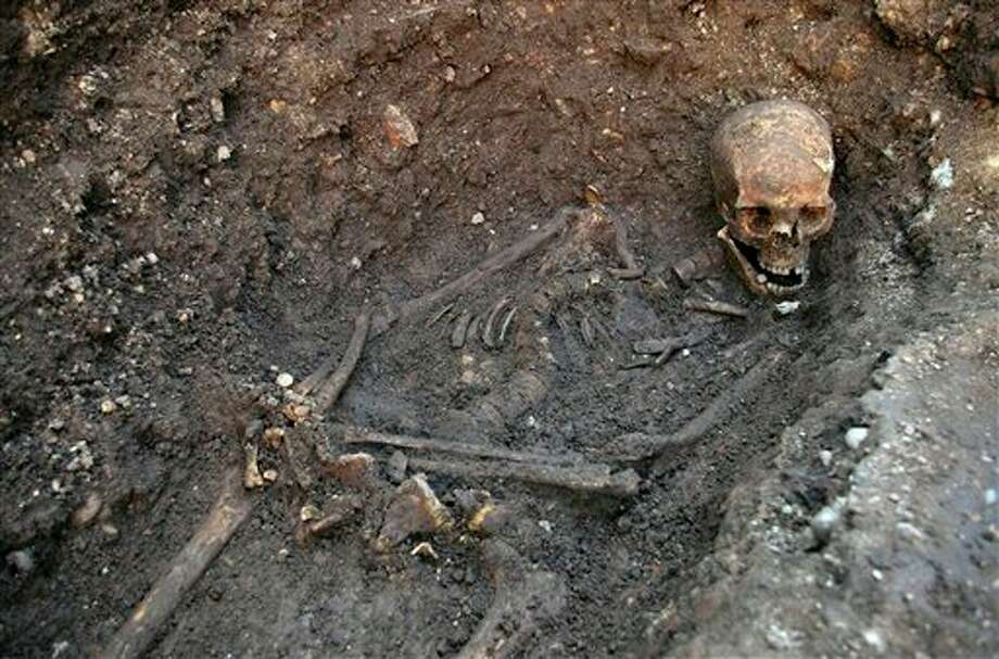 "Undated photo made available by the University of Leicester, England, Monday Feb. 4 2013 of the remains found underneath a car park last September at the Grey Friars excavation in Leicester, which have been declared Monday ""beyond reasonable doubt"" to be the long lost remains of England's King Richard III, missing for 500 years. Richard was immortalized in a play by Shakespeare as a hunchbacked usurper who left a trail of bodies — including those of his two young nephews, murdered in the Tower of London — on his way to the throne. (AP Photo/ University of Leicester) Photo: University Of Leicester / AP2013"