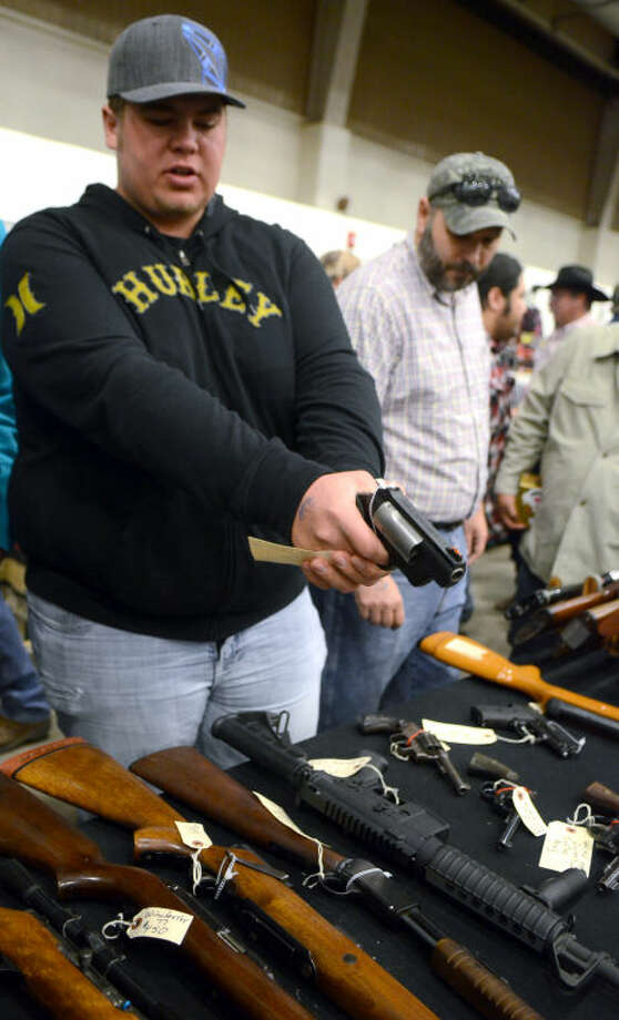 Dennis Friesen of Seminole checks out a Taurus Public Defender revolver at the Silver Spur Gun and Blade Show Saturday at Horseshoe Arena. James Durbin/Reporter-Telegram Photo: JAMES DURBIN
