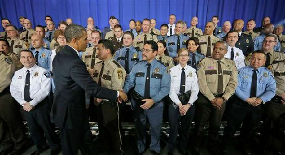 President Barack Obama greets law enforcement officers after speaking on ideas to reduce gun violence, Monday, Feb. 4, 2013, at the Minneapolis Police Department Special Operations in Minneapolis, Minn. (AP Photo/Pablo Martinez Monsivais) Photo: Pablo Martinez Monsivais / AP