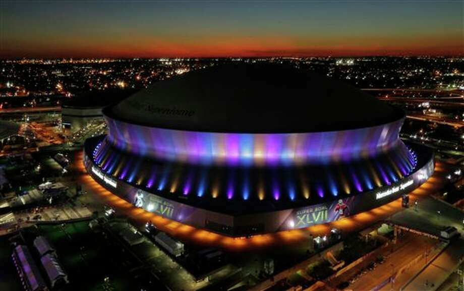 The Superdome, where the NFL Super Bowl XLVII football game between the San Francisco 49ers and Baltimore Ravens will be played, is seen at sunset Friday, Feb. 1, 2013, in New Orleans. (AP Photo/Charlie Riedel) Photo: Charlie Riedel / AP