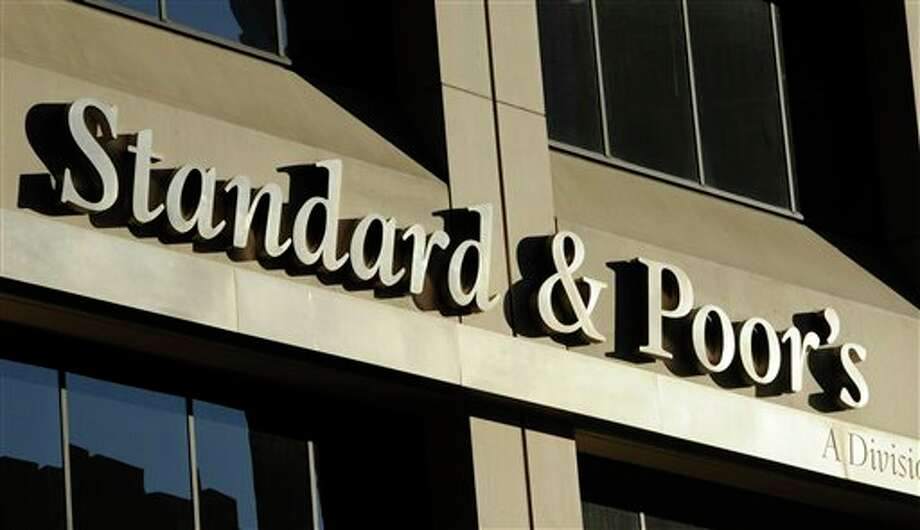 FILE - This Oct. 9, 2011 file photo shows 55 Water Street, home of Standard & Poor's, in New York. S&P said Monday, Feb. 4, 2013, the U.S. government is expected to file civil charges against Standard & Poor's Ratings Services, alleging that it improperly gave high ratings to mortgage debt that later plunged in value and helped fuel the 2008 financial crisis. The charges would mark the first enforcement action the government has taken against a major rating agency involving the worst financial crisis since the Great Depression. (AP Photo/Henny Ray Abrams, File) Photo: Henny Ray Abrams / A2011