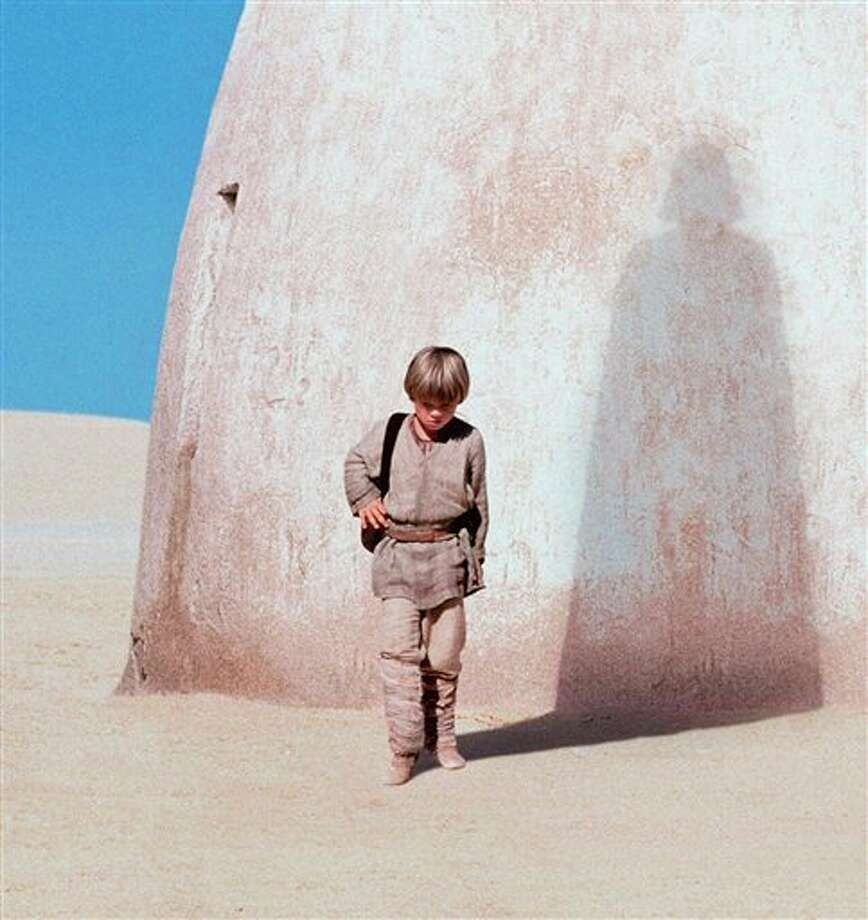 "FILE - In this publicity photo released by Lucasfilm Ltd., actor Jake Lloyd portrays Anakin Skywalker, a young Darth Vader, in ""Star Wars: Episode I, The Phantom Menace."" Walt Disney Co. CEO Bob Iger says screenwriters Larry Kasdan and Simon Kinberg are both working on standalone ""Star Wars"" movies not part of a new planned trilogy. Iger told CNBC on Tuesday, Feb. 5, 2013, that the standalone movies will be based on ""great 'Star Wars' characters that are not part of the overall saga."" (AP Photo/Lucasfilm Ltd., file) Photo: Anonymous / LUCASFILM LTD."