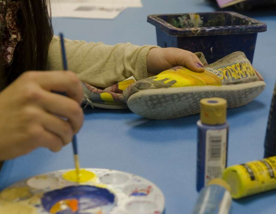 Midland High sophomore Bianca Ambrosio works on repainting a pair of her shoes during art class at school. Photo by Tim Fischer/Midland Reporter-Telegram Photo: Tim Fischer