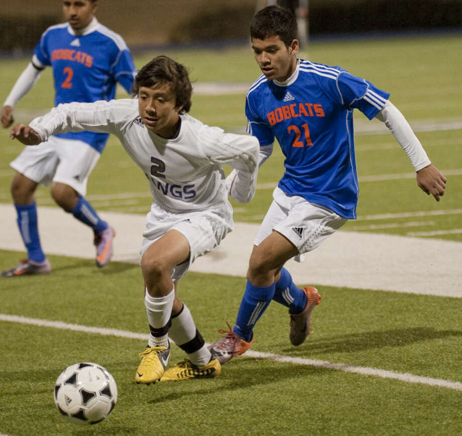 Midland High's Marcus Davis goes after the ball as San Angelo Central's Angel Gonzalez chases Tuesday evening at Grande Communications Stadium. Tim Fischer\Reporter-Telegram Photo: Tim Fischer