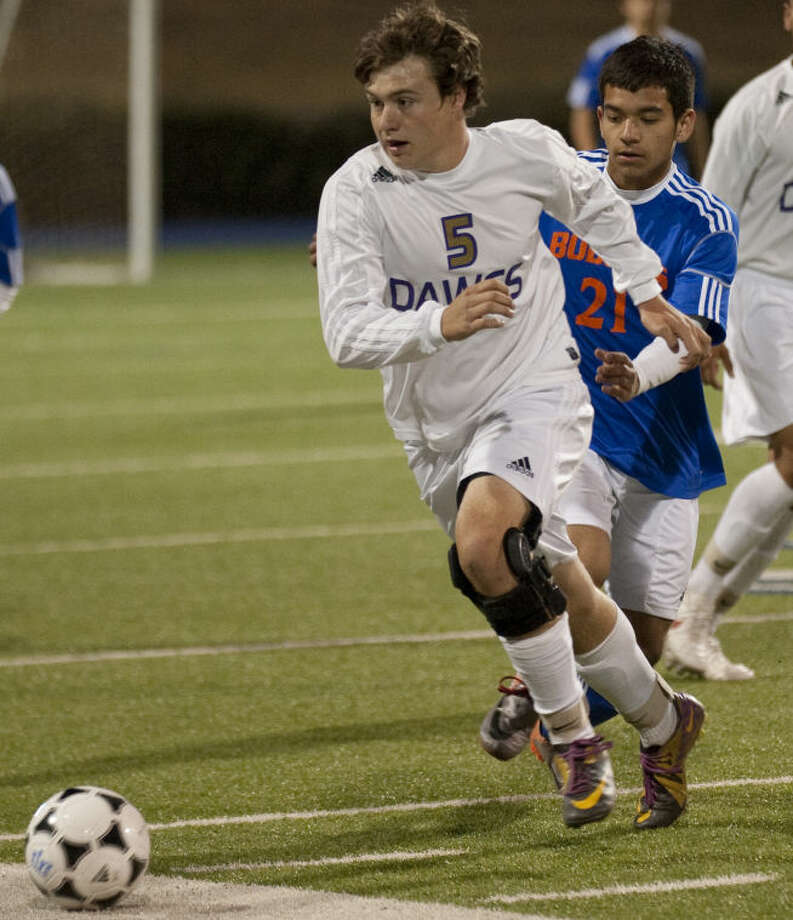 Midland High's Bart Conner chases after the ball as San Angelo Central's Angel Gozalez chases after him Tuesday evening at Grande Communications Stadium. Tim Fischer\Reporter-Telegram Photo: Tim Fischer