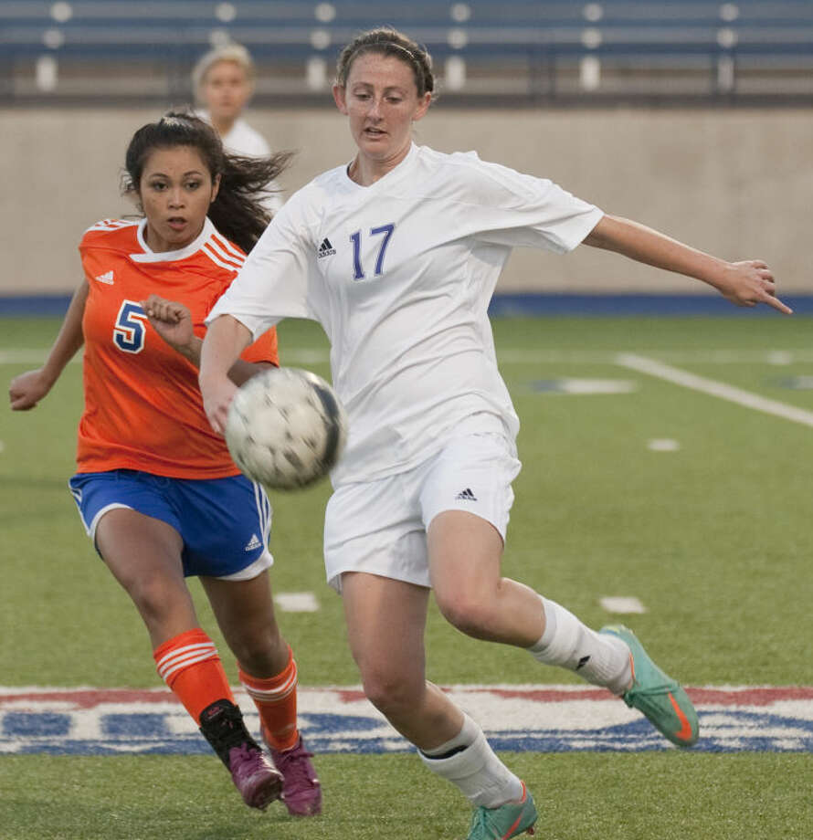 Midland High's Sarah Krisa controls the ball as she keeps it away from San Angelo Central's Morgan Lowman Tuesday evening at Grande Communications Stadium. Tim Fischer\Reporter-Telegram Photo: Tim Fischer