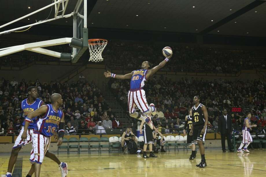 Harlem Globetrotter Bull prepares to dunk the ball Wednesday during the Globetrotters World Championship game against Elite at the Chaparral Center. Cindeka Nealy/Reporter-Telegram Photo: Cindeka Nealy
