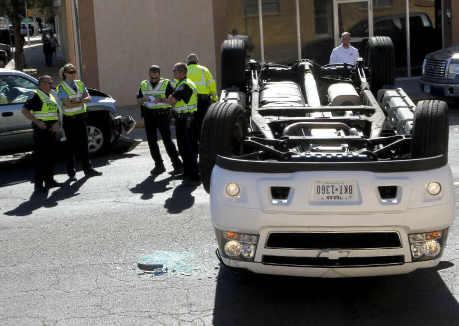 The driver of a white pickup failed to yield at a stop sign and collided with a silver SUV Wednesday at the intersection of Ohio and Colorado, leading to a rollover. No injuries were reported. James Durbin/Reporter-Telegram Photo: JAMES DURBIN