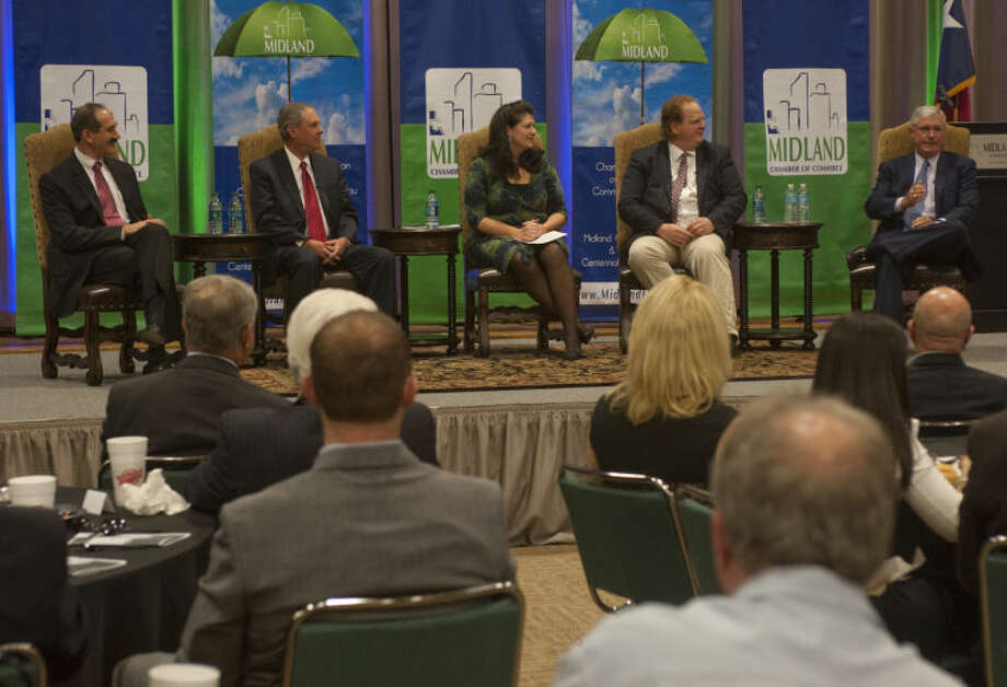 A panelist discussion with Mitch Mamoulides with Chevron, Ken Burgess with FirstCapital Bank of Texas, moderator Laura Roman, Andrew Nelson with XCOR Aerospace and Timothy Leach with Concho Resources during the 2013 State of the Economy luncheon by Midland Chamber and Midland Development Corp. Tim Fischer\Reporter-Telegram Photo: Tim Fischer