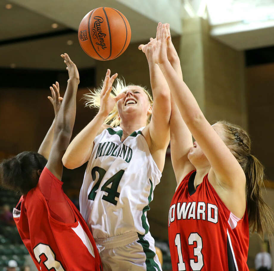 Midland College's Catherine Kruschke (24) goes up for two of her team- high 16points in WJCAC action Monday night against Howard College at AL G. Langford Chaparral Center. The Lady Chaps held off the Hawks, 63-62. Photo: Wade H Clay