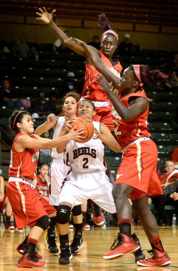 Lee's Alli Valdez (2) tries to pull down a rebound while being triple-teamed by Lubbock Coronado's Ashlee Villarreal (10), Suzzy Dimba (33), and Lizzy Dimba (32) Tuesday at Chaparral Center. James Durbin/Reporter-Telegram Photo: JAMES DURBIN