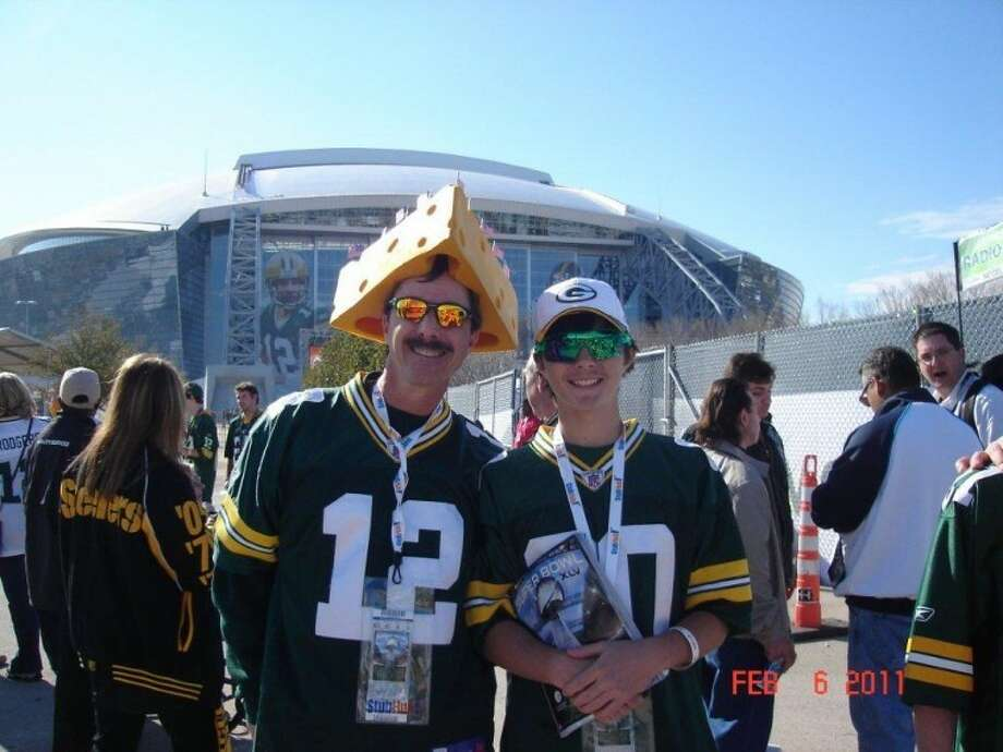 (File Photo) Brian and Adam Ball pose outside Cowboys Stadium in Arlington. Photo: Courtesy Photo