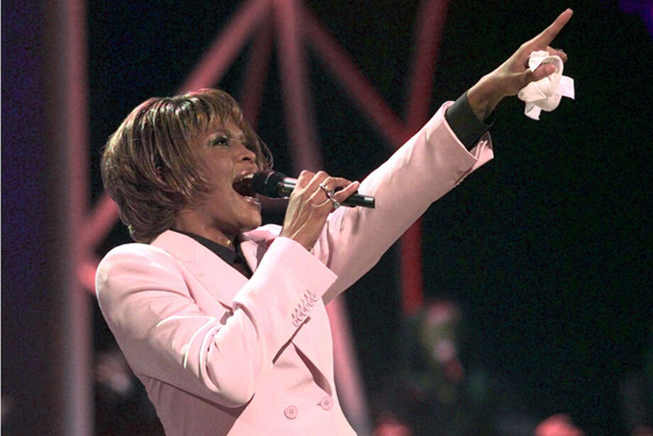 "FILE - In this July 11, 1999, file photo, singer Whitney Houston performs ""Until You Come Back To Me"" during the 26th annual American Music Awards at the Shrine Auditorium in Los Angeles. Publicist Kristen Foster said, Saturday, Feb. 11, 2012, that singer Whitney Houston has died at age 48. (AP Photo/Kevork Djansezian, File) Photo: KEVORK DJANSEZIAN / AP1999"