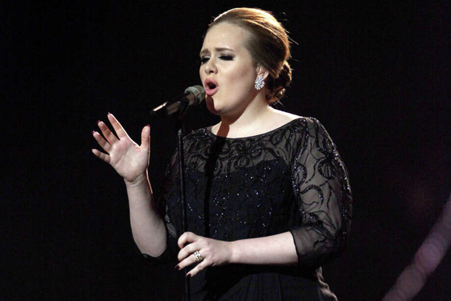 FILE - In this Feb. 15, 2011 file photo, Adele performs on stage during the Brit Awards 2011, at The O2 Arena in London. Adele, who had surgery on her vocal cords last year, will perform at the Grammys on Feb. 12, 2012. She is also nominated for six awards. (AP Photo/Joel Ryan, file) Photo: Joel Ryan / AP2011