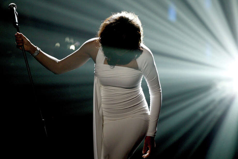 In this Sunday, Nov. 22, 2009, file photo, Artist Whitney Houston performs onstage at the 37th Annual American Music Awards in Los Angeles. Houston died Saturday, Feb. 11, 2012, she was 48. (AP Photo/Matt Sayles, File) Photo: Matt Sayles / AP2009