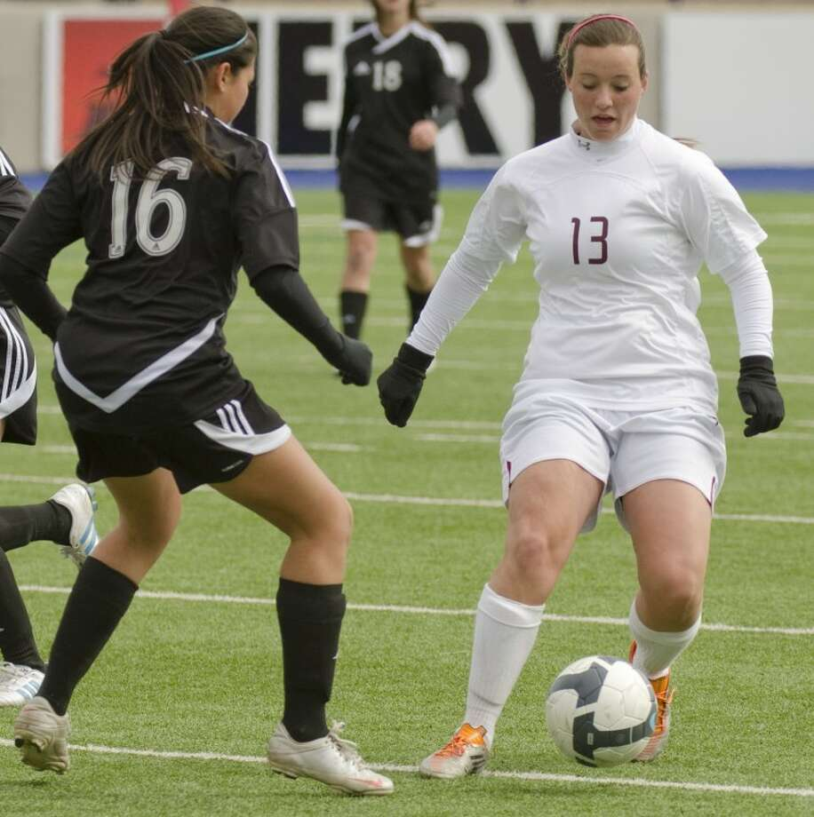 Lee's Erin Cumbest tries to get around Permian's Briana Anaya Saturday afternoon at Grande Communications Stadium. Photo by Tim Fischer/Midland Reporter-Telegram Photo: Tim Fischer