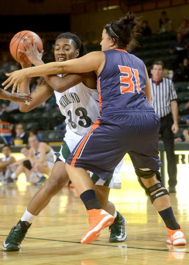 Midland College's Achiri Ade tries to get around South Plains' Jasmine Brainard to score Thursday at Chaparral Center. James Durbin/Reporter-Telegram Photo: JAMES DURBIN