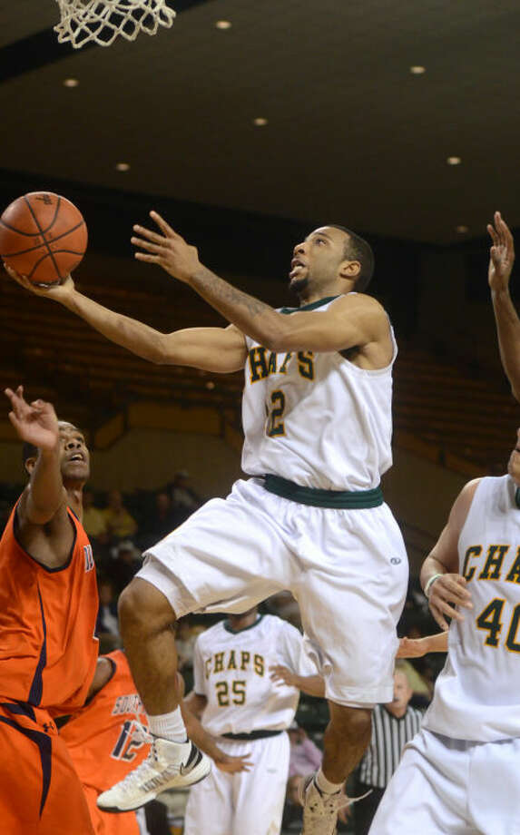 Midland College's Corey Hilliard attempts a layup against South Plains' Yanick Moreira on Feb. 7 at Chaparral Center. James Durbin/Reporter-Telegram Photo: JAMES DURBIN