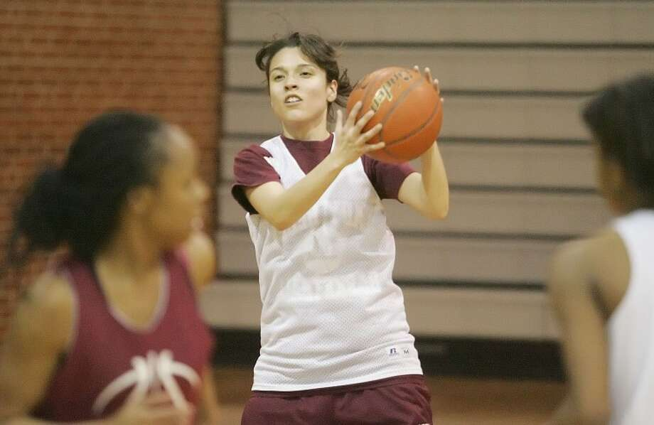 Karla De La Torre looks to pass the ball as the Lady Rebels work on offensive and defensive drills Thursday at Midland High School. Cindeka Nealy/Reporter-Telegram Photo: Cindeka Nealy