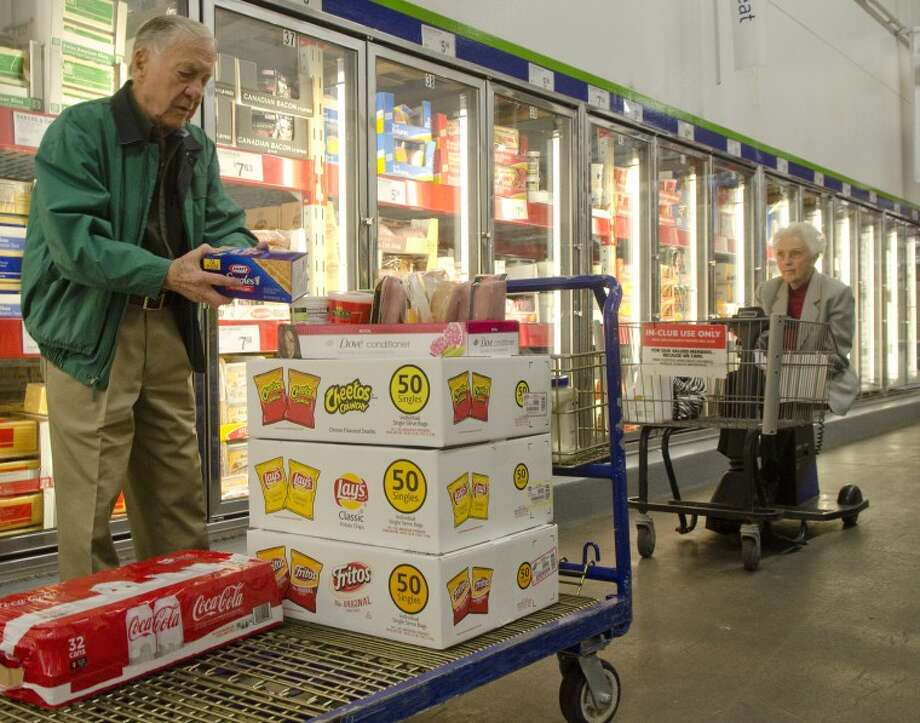 Mary and John Crosby shop Monday morning at Sam's Club during their weekly trip to make food and stock the refrigerator at Hope House. Photo by Tim Fischer/Midland Reporter-Telegram Photo: Tim Fischer