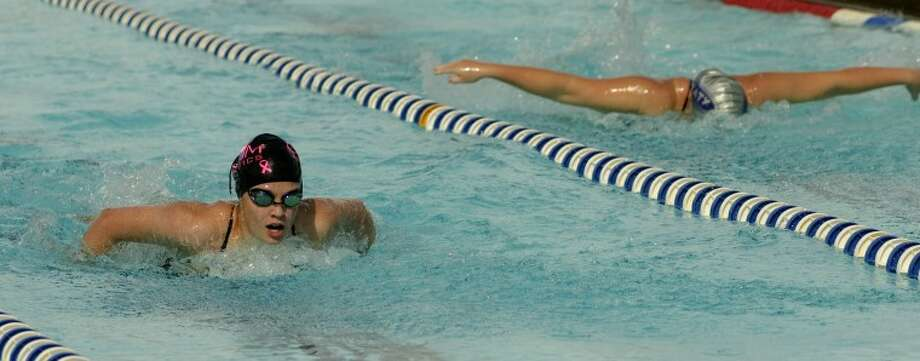 COM's Alyson Drennan, left, and Katy's Bella Alnis compete in the girls 13 and over 200m butterfly Friday at the WNB 2012 Invitational swim meet at Doug Russell Pool. Photo by Tim Fischer/Midland Reporter-Telegram Photo: Tim Fischer