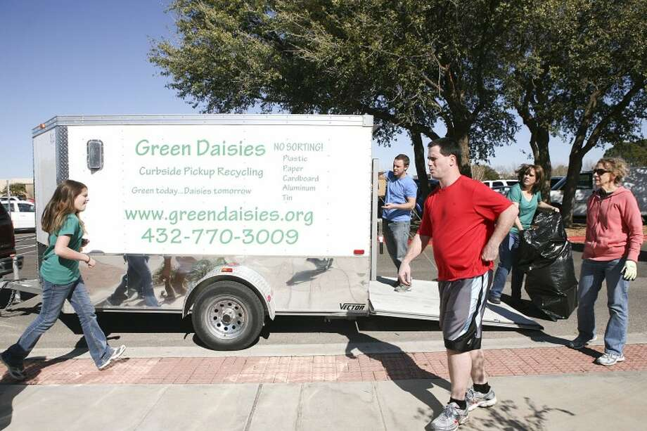 Daisy Bermes, 10, and members of the Midland College Student Government organization prepare to load recyclable materials into the Green Daisies trailer Friday at Midland College. Cindeka Nealy/Reporter-Telegram Photo: Cindeka Nealy