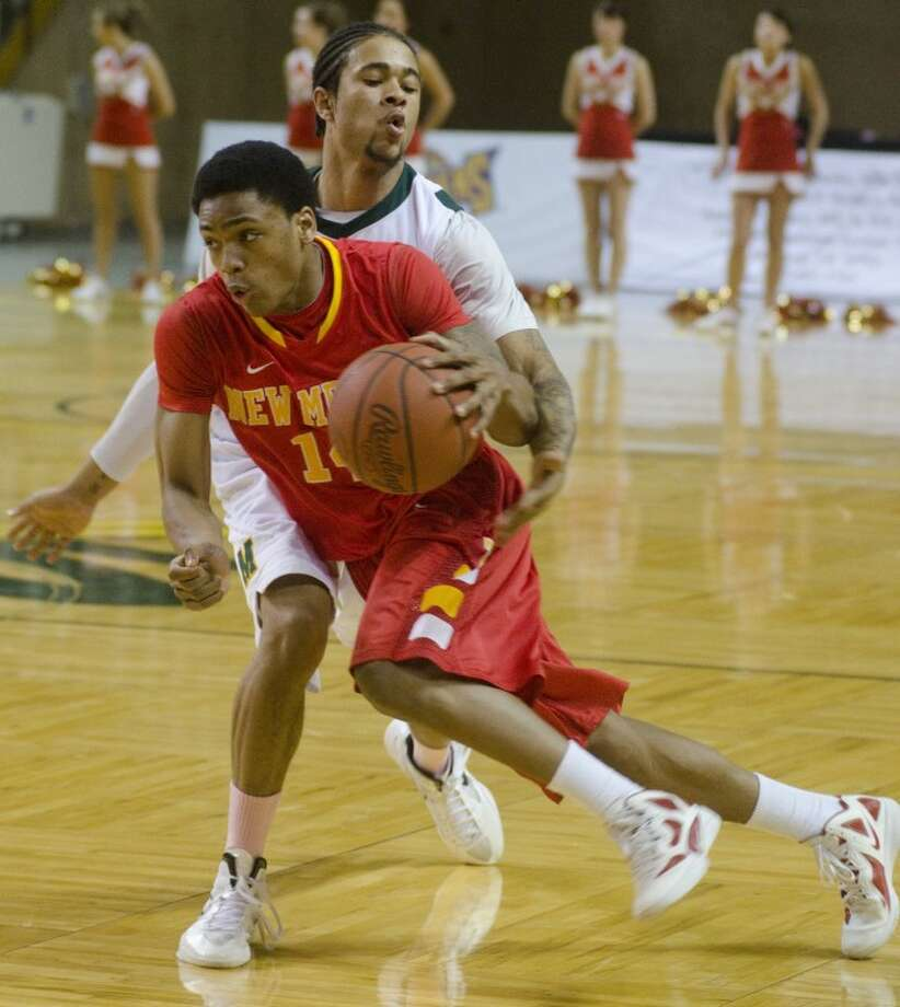 Midland College's Tre Bowman tries to knock the ball away as NMJC's Robert Turner drives around him Monday night at Chaparral Center. Photo by Tim Fischer/Midland Reporter-Telegram Photo: Tim Fischer