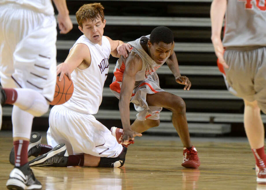 Lee's Grant Coffman steals a loose ball away from Odessa's Rashaun Black Tuesday at Chaparral Center. James Durbin/Reporter-Telegram Photo: JAMES DURBIN