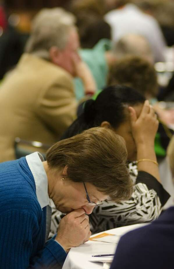 Rhonda Carr and others bow thier heads during a time of personal prayer Wednesday morning at the National Prayer Breakfast. Photo by Tim Fischer/Midland Reporter-Telegram Photo: Tim Fischer