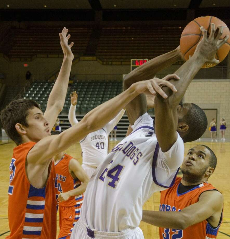 San Angelo Central's Zach Whilock fouls Midland High's Donavon Lee as he takes a shot Tuesday evening at Chapparal Center. Photo: Tim Fischer