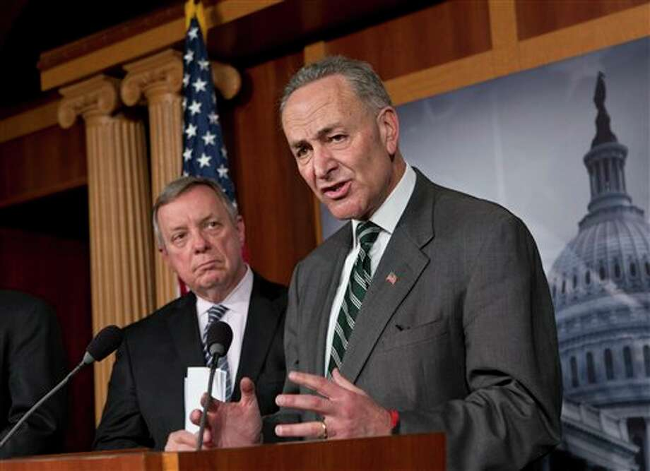 Sen. Charles Schumer, D-N.Y., right, and Sen. Dick Durbin, D-Ill., left, join a bipartisan group of leading senators announce that they have reached agreement on the principles of sweeping legislation to rewrite the nation's immigration laws, during a news conference at the Capitol in Washington, Monday, Jan. 28, 2013. The deal covers border security, guest workers and employer verification, as well as a path to citizenship for the 11 million illegal immigrants already in this country. (AP Photo/J. Scott Applewhite) Photo: J. Scott Applewhite / AP2013