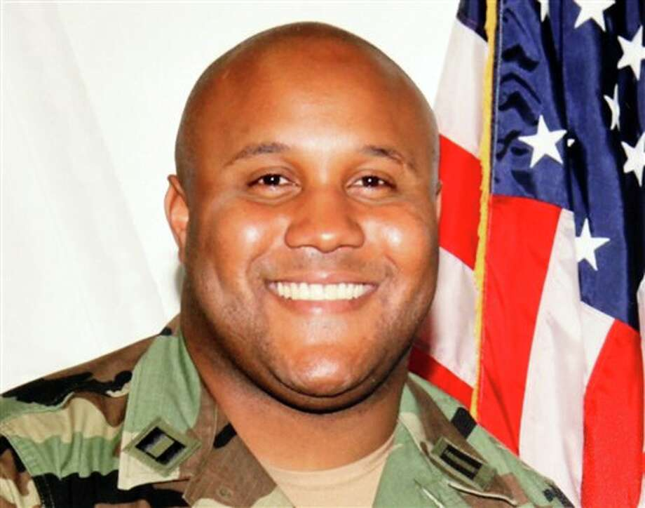 This undated photo released by the Los Angeles Police Department shows suspect Christopher Dorner, a former Los Angeles officer. Seeking leads in a massive manhunt, Los Angeles authorities on Sunday put up a $1 million reward for information leading to the arrest of Christopher Dorner, the former Los Angeles police officer suspected in three killings. (AP Photo/Los Angeles Police Department) Photo: Uncredited / Los Angeles Police