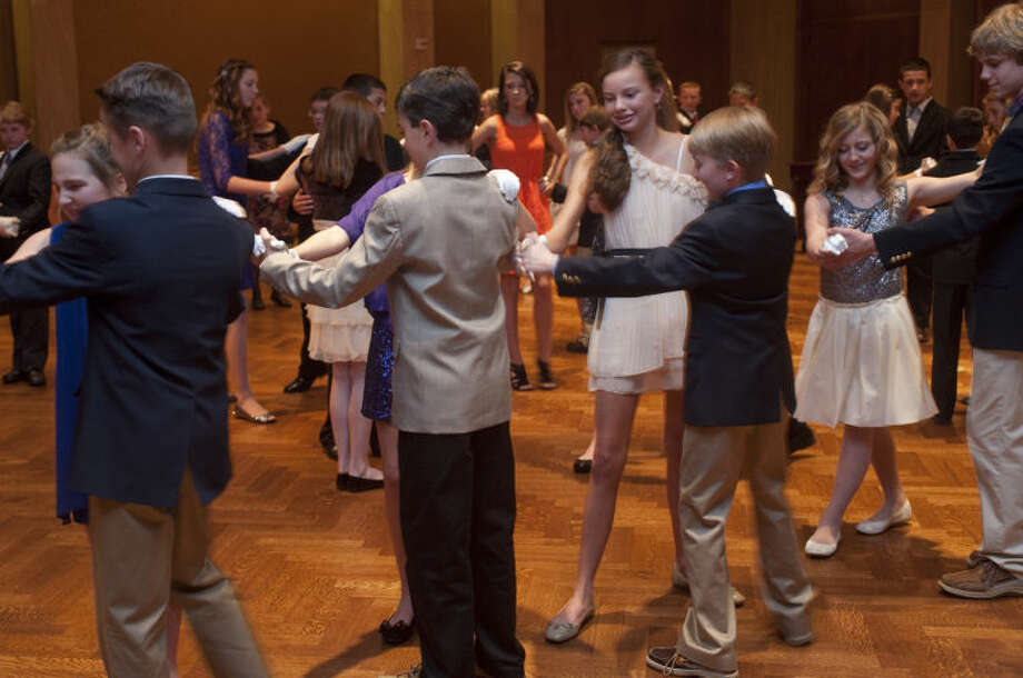 Area youngsters learn the art of dance and manners during a Cotillion lesson Monday evening at the Petroleum Club. Tim Fischer\Reporter-Telegram Photo: Tim Fischer