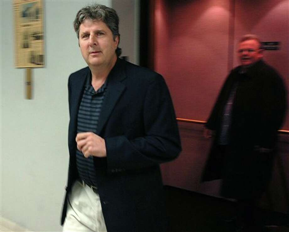 FILE - In this March 12, 2010 file photo, former Texas Tech football coach Mike Leach, left, arrives with his attorney Ted Liggett to give a videotaped deposition in Lubbock, Texas. Photo: (AP Photo/Lubbock Avalanche-Journal, Zach Long) / Lubbock Avalanche-Journal