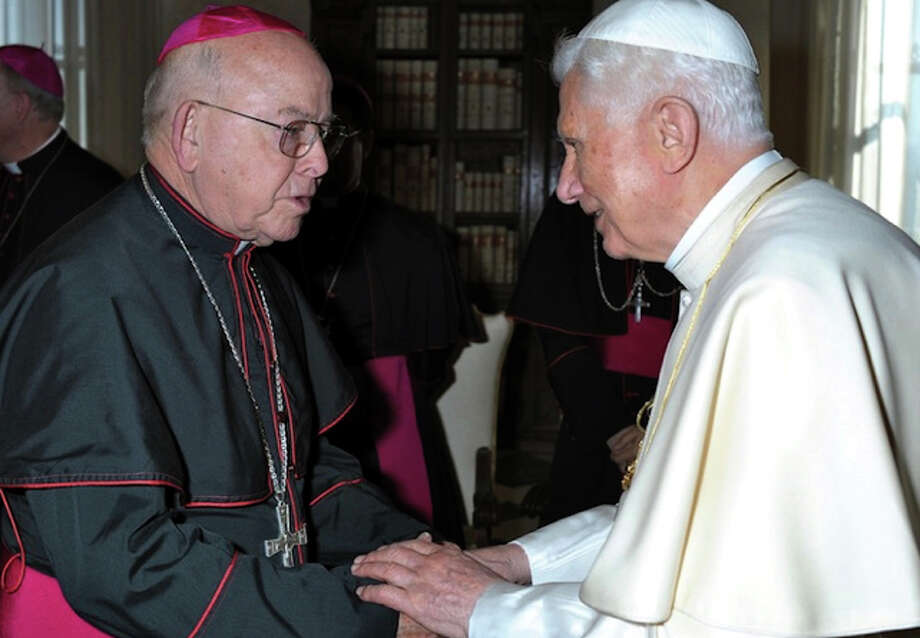 (File Photo) Pope Benedict XVI greets San Angelo Bishop Michael D. Pfeifer during a March 16 meeting at the Vatican. Bishops from Texas, Oklahoma and Arkansas were making their ad limina visits to the Vatican to report on the status of their dioceses. (CNS photo/L'Osservatore Romano) (March 16, 2012)