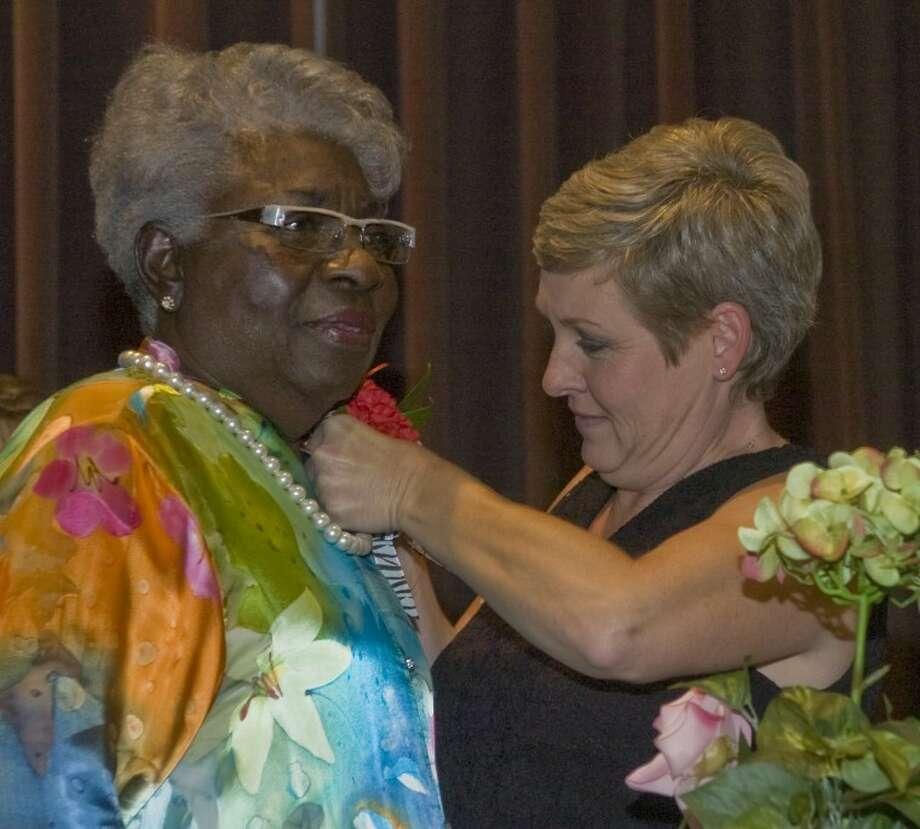 (File Photo) Barbara Yarbrough receives a corsage Saturday night as she is honored and roasted for her 51 years of service with MISD, as well as her 75th birthday. Photo: Tim Fischer