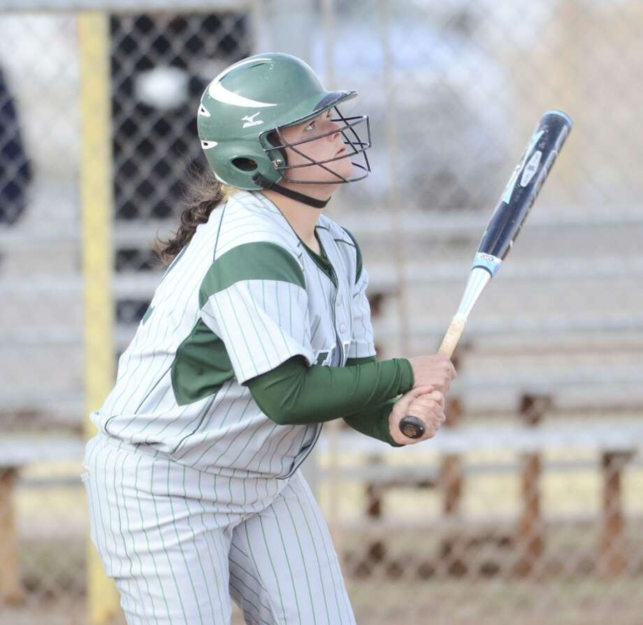 Midland College's Carly Weidenbach (22) watches her ball sail over the fence after hitting a homerun Saturday during the Lady Chaparrals game against Las Adelitas at Freddie Ezell Softball Complex. Cindeka Nealy/Reporter-Telegram Photo: Cindeka Nealy