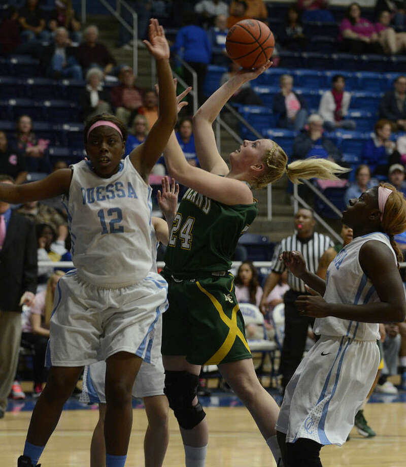 Midland College's Catherine Kruschke (24) shoot over Odessa College's Kiera Waters (12) during the first half of their conference basketball game Monday at the OC Sports Center. Photo: Mark Sterkel|Odessa American