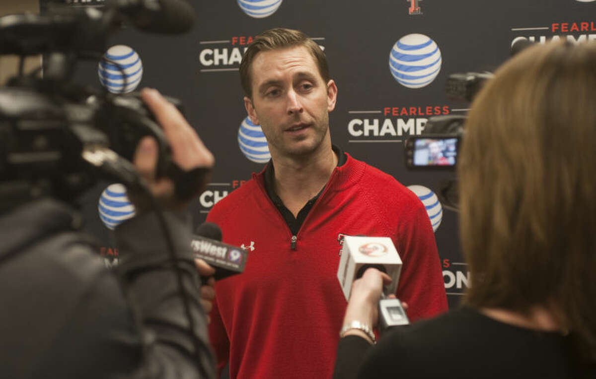 Texas Tech head football coach Kliff Kingsbury talks with the media Monday evening before a scholarship dinner at the Midland Center. Tim Fischer\Reporter-Telegram