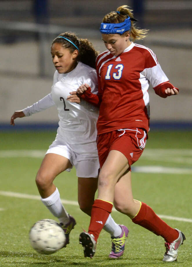 Lee's Deo'nna Calhoun fights against Abilene Cooper's Stephanie Clements for control of the ball Tuesday at Grande Communications Stadium. James Durbin/Reporter-Telegram Photo: JAMES DURBIN