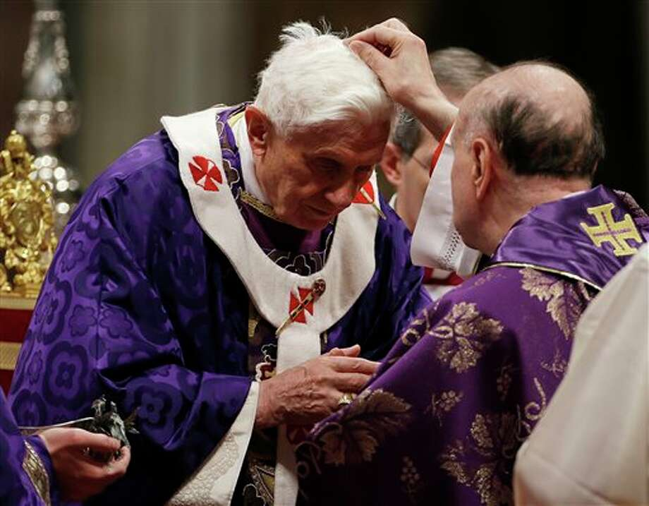"Cardinal Angelo Comastri puts ash on Pope Benedict XVI's head during the celebration of Ash Wednesday mass in St. Peter's Basilica at the Vatican, Wednesday, Feb. 13, 2013. Ash Wednesday marks the beginning of Lent, a solemn period of 40 days of prayer and self-denial leading up to Easter. Pope Benedict XVI told thousands of faithful Wednesday that he was resigning for ""the good of the church"", an extraordinary scene of a pope explaining himself to his flock that unfolded in his first appearance since dropping the bombshell announcement. (AP Photo/Gregorio Borgia) Photo: Gregorio Borgia / AP2013"