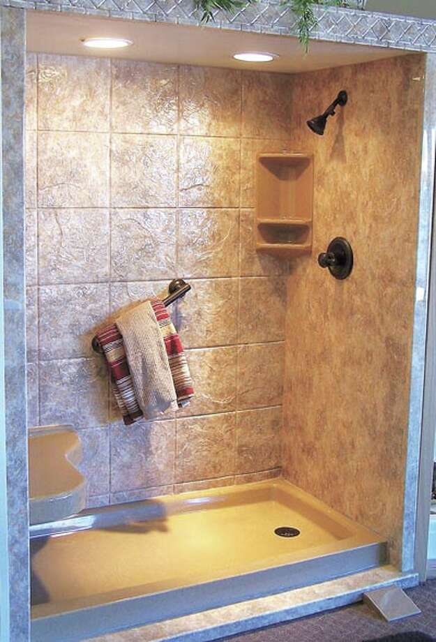 This earth-tone design is a wonderful tub-to-shower conversion from Luxury Bath. Call 218-6448 to learn more.